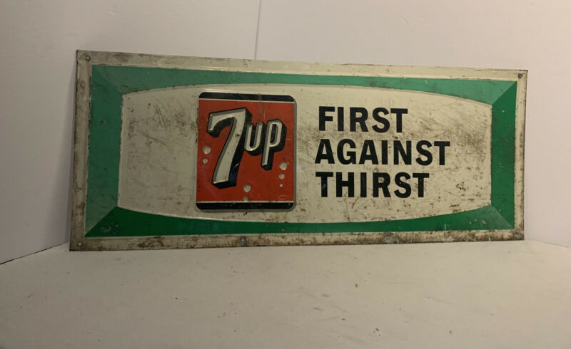 Embossed Vintage 7-Up First Against Thirst Metal Sign