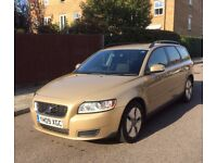 Volvo V50 DRIVe 1.6D 2009 with roof box and bike rack
