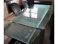 Dining Table Glass Extending and 6 black faux leather chairs seats