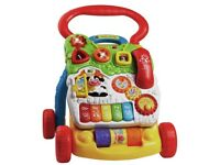Vtech baby push along walker toy