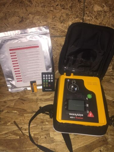 NEW Welch Allyn AED 10 Trainer with NEW Pads, NEW Battery, Case and Remote