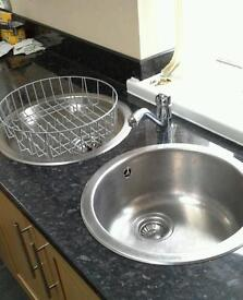 Kitchen sinks with tap