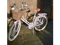 Ladies pink Amsterdam style bicycle