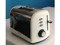 cream and stainless steel 2 slice toaster graded with 12 month warranty