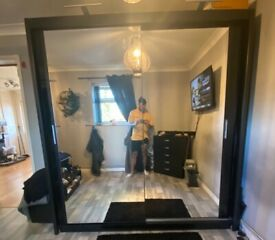 Double mirror sliding wardrobe