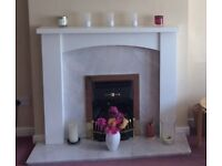 Marble fireplace backplate and hearth plus wooden surround.