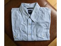 Western style shirt by Gap. Blue. Ivory colour press stud / fasteners. Size Large. 100% Cotton.