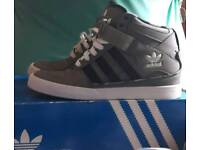 Black and gray high tops size 5.5