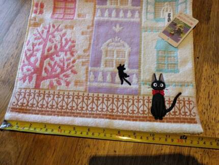 Kiki's Delivery Service Jiji cat towel featuring clock tower