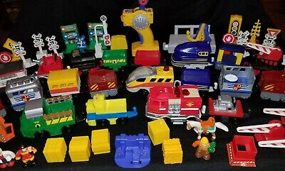 HUGE Fisher Price Geotrax Lot Over 50 Pieces Trains Trucks Signs and more!