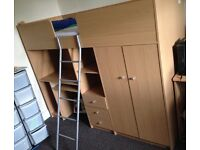 Children's single cabin bed with wardrobe, drawers, shelves and desk
