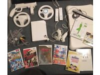 Nintendo Wii console and accessories bundle including games and wii-fit board