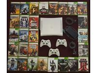 xbox 360 console with all leads ,3 controllers, 1 rechargable, plus 28 great games