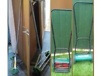 Manual grass cutter and aerator.