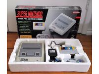 super nintendo boxed with mario world snes console