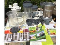 juicer/ blender NutriBullet Pro 900 Series Juicer Blender with books ect lots of pieces with it