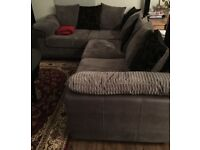 Like new corner sofa. Grey with black cushions.