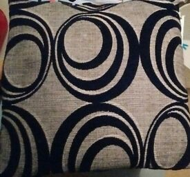 Three Black and Silver Cushions