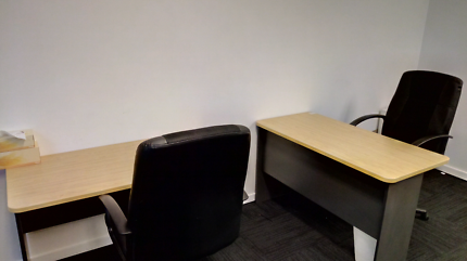 2 desks with 2 chairs