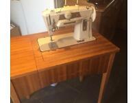 Singer sewing machine with original manuals.