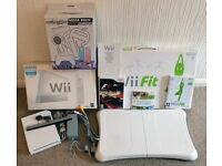 Nintendo Wii Console and Wii Fit Board + F1 Game and Accessory Pack
