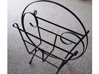 Vintage mid-century black metal magazine rack for sale