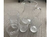 Large glass jug and glasses.