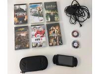 Sony PSP Black with 8 Games and Case.