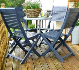 Garden table and 5 chairs with seat pads