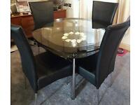Harveys Round Glass Table and 4 Marilyn chairs