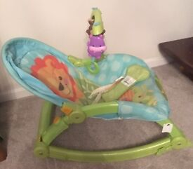 Fisher Price Newborn to Toddler rocker with hanging toys. Can be static seat. Excellent condition.