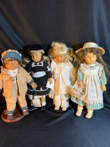 4 Wooden Camelot Handcrafted dolls purchased from QVC in 1991