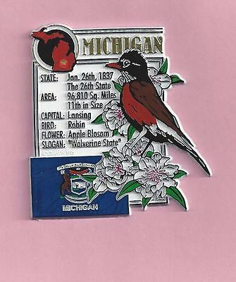MICHIGAN  STATE MONTAGE FACTS MAGNET with state  bird  flower  and flag,