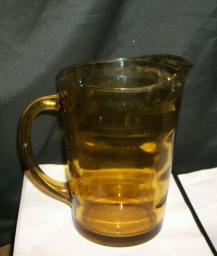 """PRE-OWNED GOLD GLASS WATER PITCHER.. 8 """" TALL"""