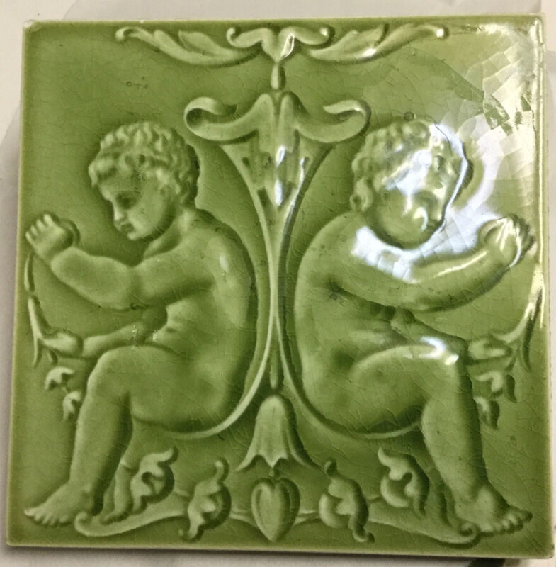 T R Boote England rare19th c relief moulded green majolica cherub tile