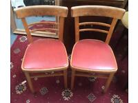 Vintage red leather wood chairs