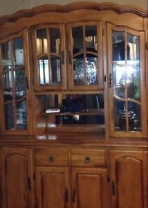 Buffet and hutch made of rubber wood.