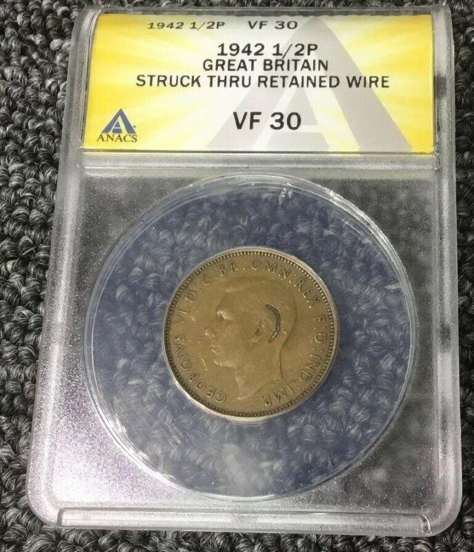 1942 1/2P STRUCK THRU RETAINED WIRE GREAT BRITAIN MINT ERROR, WIRE BEHIND EAR