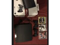 PS3 with box, controllers and games