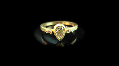 14K solid Yellow gold handmade ring set with a drop-shaped 0.35ct rough Diamant.
