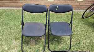 Two black folding chairs - $3 Regents Park Auburn Area Preview
