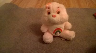 pink cheer care bear with rainbow symbol small from the 80s  - Cheer Bear Symbol