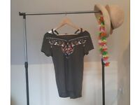 Cold shoulder top with Aztec pattern