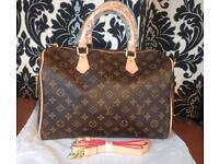 Louis Vuitton Speedy Handbag With Straps