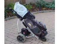 Electric Golf Trolley with 2 Batteries Charger and golf bag.