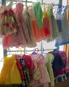 A large variety of girls dresses.   Sizes 0-6