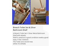 BRAND NEW BREECH TOILET SET AND USED SILVER BATHROOM SHELF
