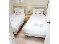 A pair of single beds or sold separately including mattresses