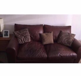 Brown leather sofa, one arm chair and a footstool