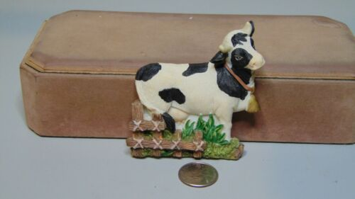"RESIN COW BY FENCE WITH BELL ON FIGURE FRIDGE MAGNET   3"" X 3 1/2"""